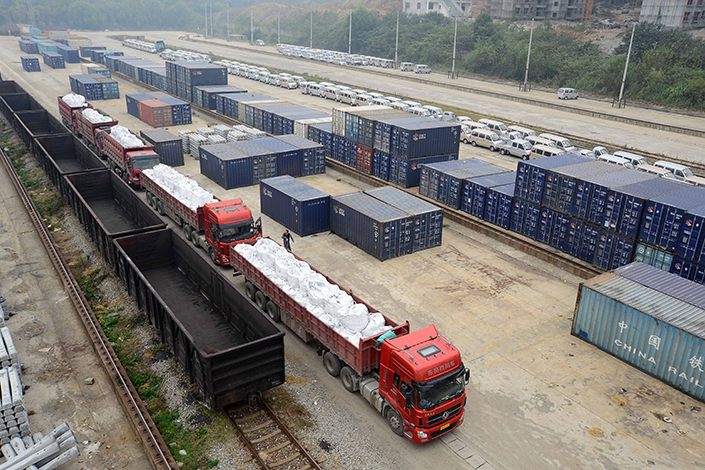 Two explosions on Wednesday rocked a rail car on an X318 train parked at a railway station in the Qianjiang district of Chongqing. Above, rail cargo is seen at the Jiujiang South Railway Station in Jiujiang, Jiangxi province, in November 2014. Photo: Visual China