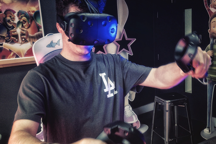 A Milky Tea employee tests the Oculus and HTC Vive in a virtual reality bar. Photo: Milky Tea Ltd.