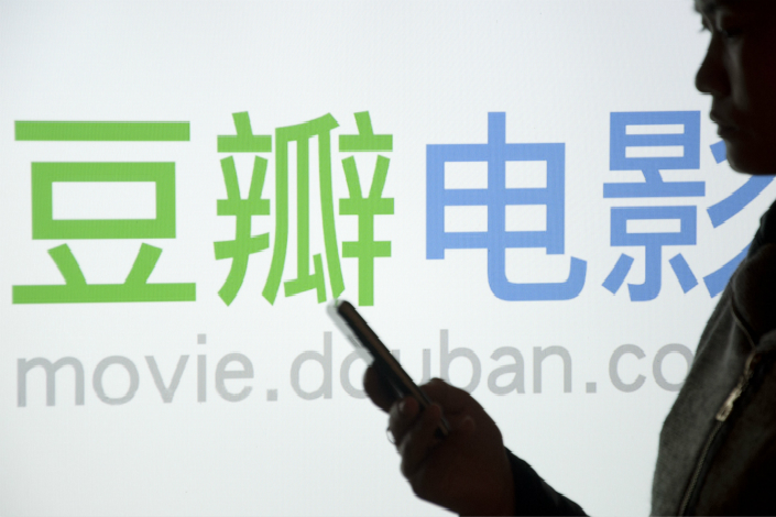 Market-watchers believe an offshore initial public offering, such as the type that Douban is reportedly seeking, could raise a company's international profile. Above, a Douban Movie logo is seen in Shaoyang, Hunan province, in March 2013. Photo: Visual China