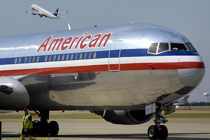A temporary suspension on new routes running from Beijing remains a final obstacle for American Airlines, which is seeking to launch a new flight between Beijing and Los Angeles. Above, an American Airlines jet sits on the tarmac at Dallas-Fort Worth International Airport in Texas in September 2009. Photo: IC