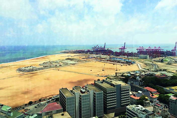 The Colombo International Financial City project is the first public-private partnership in Sri Lanka for  China Communications Construction Co. Ltd. Above, excavated land that is part of the International Financial City project is seen from the top of the Colombo World Trade Center. Photo: Caixin reporter, Yuan Suwen.