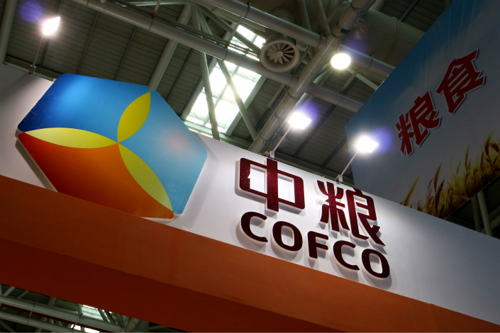 COFCO's CPMC Holdings Ltd. packaging unit plans to buy about 30% of JDB Group subsidiary Qingyuan JDB Herbal Plant Technology Co. Ltd. Above, COFCO hosts an exhibition booth at the 13th Cross-Straits Technology and Projects Fair in June 2015 in Fuzhou, Fujian province. Photo: Visual China