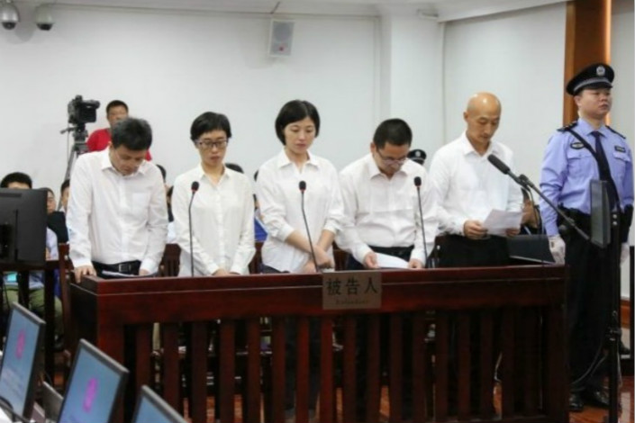 Suspects, including one former business partner and four employees of fugitive billionaire Guo Wengui, stand trial on Friday at a court in Dalian, Liaoning province. Photo: Dalian Xigang District People's Court