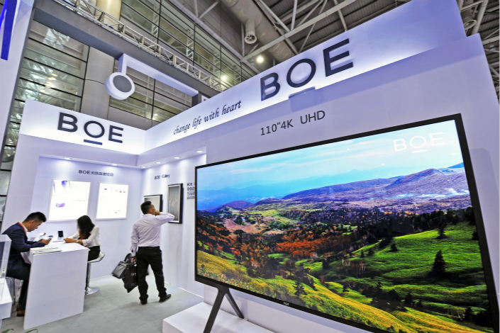 BOE Technology Group Co. Ltd.'s production line in Wuhan is slated to begin operation in 2019 with an initial monthly capacity of 120,000 panels. Above, BOE showcases its 110-inch and 4K ultra-high-definition televisions on June 19 at the 15th China Cross-Straits Technology and Projects Fair in Fuzhou, Fujian province. Photo: Visual China