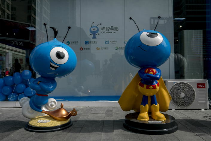 New users of Ant Financial Services Group's Yu'e Bao money market fund can now invest only up to 100,000 yuan ($15,000), down from 1 million yuan in May. Above, Ant Financial mascots are displayed in Chengdu, Suchuan province, in September 2015. Photo: Visual China