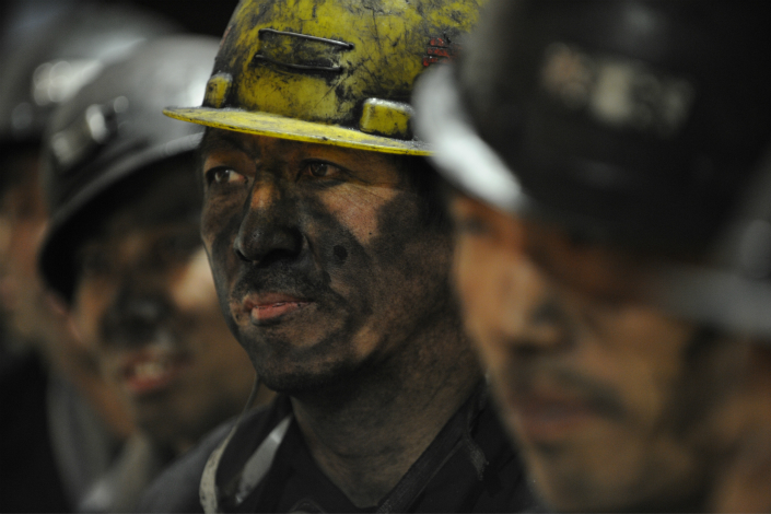 Coal dust covers the face of miners in November 2010 in Shanxi province. Authorities have decided to cut the country's coal-fired power generation capacity over the latter half of the decade to deal with a glut in the industry. Photo: Visual China