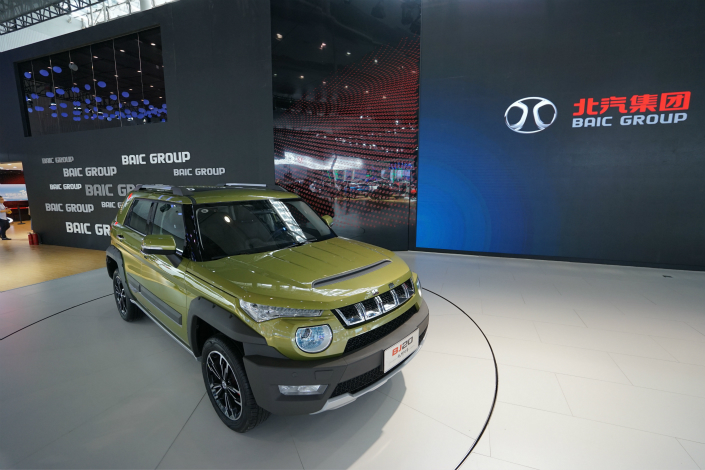 BAIC BJEV, BAIC Motor's new-energy unit, has received new funding from 14 investors, ratcheting up the unit's value to 28 billion yuan. Above, BAIC Group hosts an exhibition group at the 14th China (Guangzhou) International Automobile Exhibition, in Guangzhou, Guangdong province, in November. Photo: IC