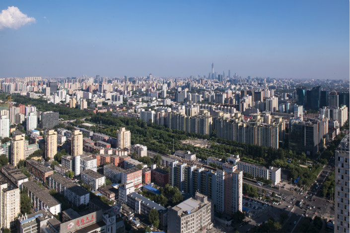 Fifteen closely watched cities, including Beijing and Shanghai, saw growth of new-home prices slow last month compared to a year ago. Above, the Beijing skyline is visible on Aug. 3. Photo: Visual China
