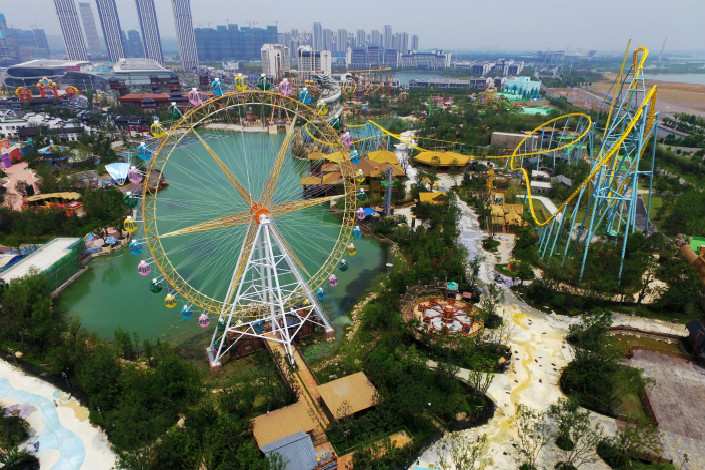 Dalian Wanda Group, the Chinese real estate conglomerate, announced a string of investments in cultural tourism projects around China. Those projects, which all received strong government support, include a $22.5 billion investment in Chongqing. Above, a Ferris wheel towers above Wanda Cultural Tourism City in eastern China's Anhui province in August 2016. Photo: IC