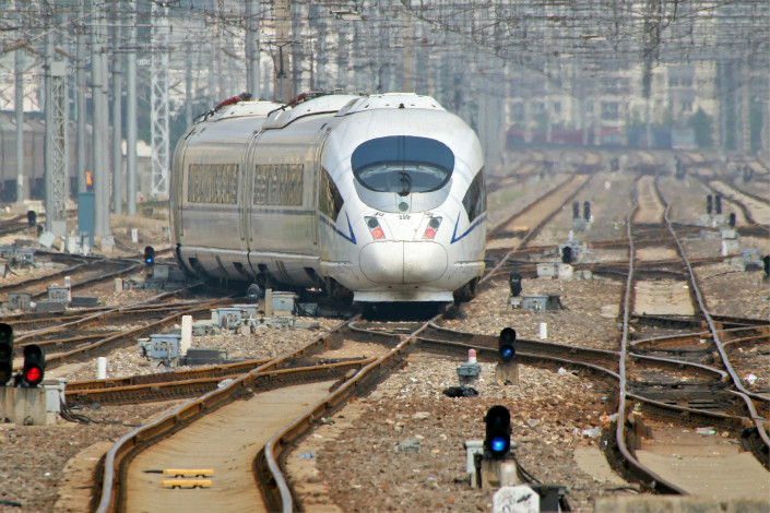 Rail-equipment maker CRRC Corp. Ltd. and China Railway Corp., CRRC's largest client, have signed an agreement in which they agree to cooperate on several contentious issues. Above, a train pulls out of the railway station in Yantai, Shandong province, on June 30. Photo: Visual China