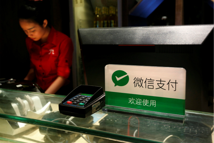 A sign welcomes customers to use WeChat Pay to pay at a restaurant in Guangzhou, Guangdong province. Standard Chartered said it has recently reached a cooperation agreement with Tencent Holding's WeChat Pay. Photo: Visual China