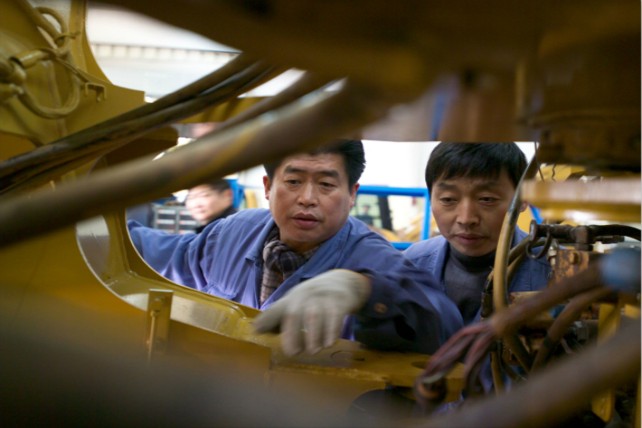 Lei Shing Hong Machinery Ltd. will buy mining equipment business WesTrac China Co. Ltd., in a move to consolidate its market position in China. Above, Lei Shing Hong employees maintain machinery in  Kunshan, Jiangsu province, in January 2016. Photo: IC