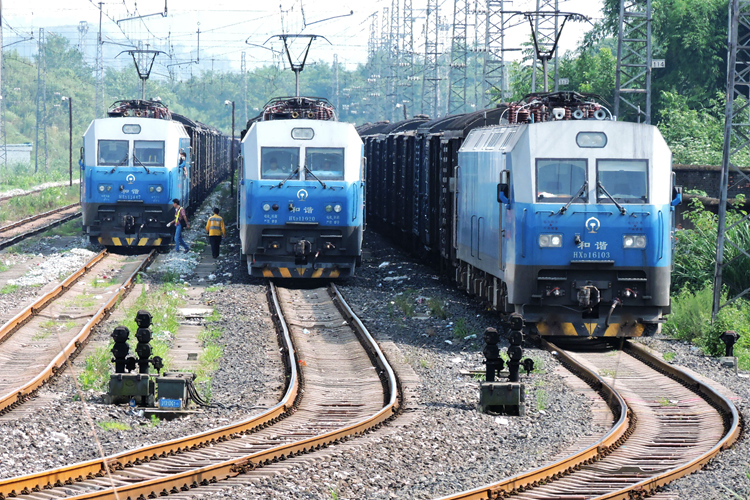 "China Railway Corp. has been pushing forward with ""mixed-ownership"" reform for its subsidiaries. Above, freight trains sit at a railway station in Dazhou, Sichuan province on July 9. Photo: Visual China"