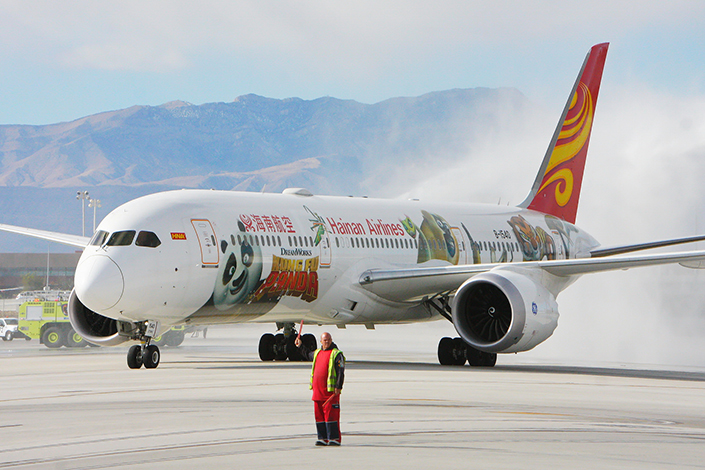 China would no longer limit international routes for many long-range destinations to a single airline if a new regulation being drafted by the country's aviation authority were to take effect. Above, a Hainan Airlines flight from Beijing lands at McCarran International Airport in Las Vegas, Nevada, in December, at the end of the first nonstop flight between the mainland and the U.S. city. Photo: Visual China