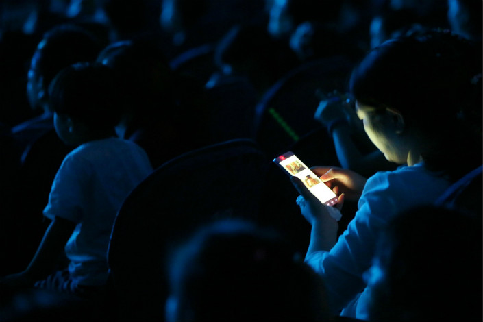 The central government's inspections of 10 online service providers ended Thursday, and the results will be announced in late September. Above, a cellphone user checks her WeChat messages in August 2016 in Xiangyang, Hubei province. Photo: IC
