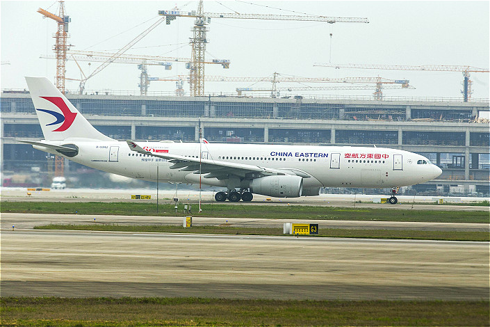 The mixed-ownership reform program aims to bring private-sector investment and management into state-owned companies to make them more dynamic. Above, a China Eastern Airlines jetliner taxis at Shanghai Pudong International Airport on May 5. Photo: IC