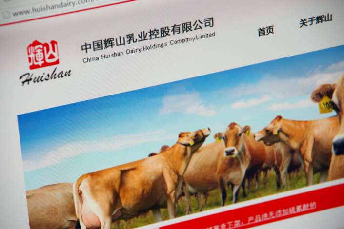 A group of 189 individual investors organized by Gopher Asset Management, one of China Huishan Dairy's creditors, said they would reject any restructuring plan in which Huishan Chairman Yang Kai continues to have control of the company. Above, the official Huishan website is seen. Photo: IC