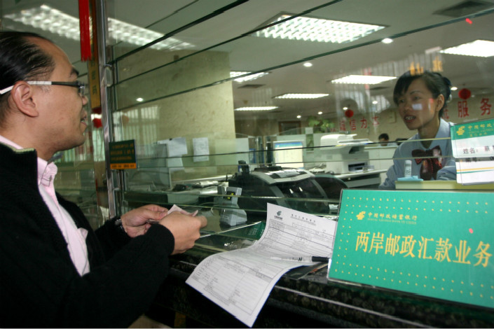 The retail-focused Postal Savings Bank of China Co. plans to sell up to 5.17 billion new A-shares, or 6% of its enlarged share capital, on the Shanghai Stock Exchange. Photo: Visual China