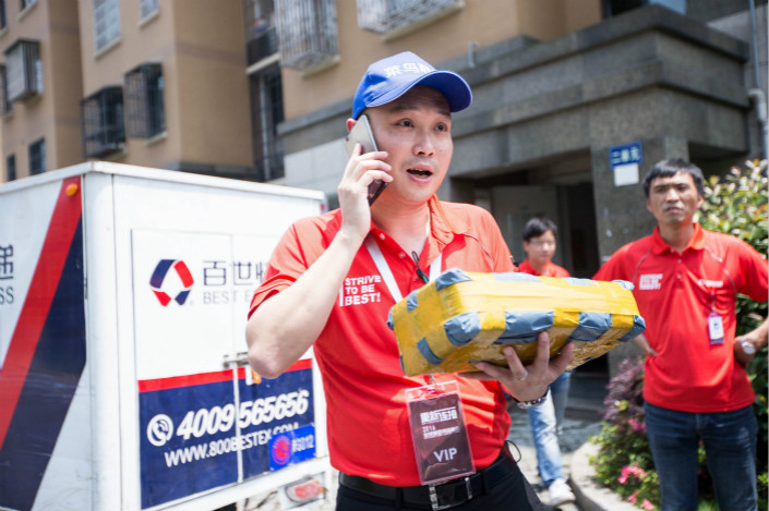 Logistics services provider Best Inc. said it netted 8.1 billion yuan ($1.23 billion) in revenue over the first six months of the year. Above, Zhou Jian, Best Inc. vice president and general manager of Best Express, phones the recipient of an online-shopping parcel during a promotional event in Hangzhou, Zhejiang province, in June 2016. Photo: Visual China