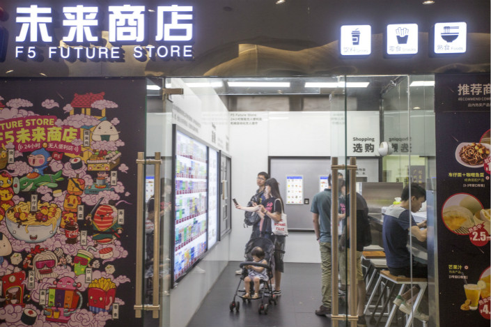 The F5 Future Store (above) in the southern city of Guangzhou is one of a growing number of staffless, brick-and-mortar shops opening in cities across China. Companies pioneering automated stores have attracted strong investor support, such as Bingobox, which raised more than 100 million yuan ($15.15 million) earlier this year. Photo: Visual China