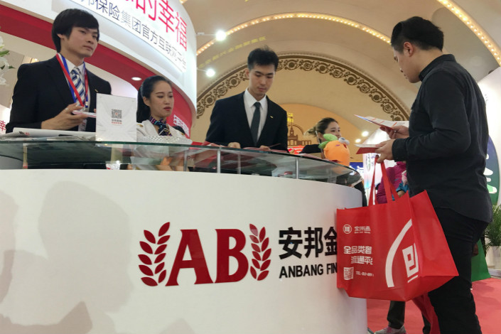Anbang Insurance Group Co.'s recent regulatory filings to the Shanghai and Hong Kong bourses show that it has substantially reduced its stake in four Chinese banks. Above, Anbang hosts an exhibition booth at the Beijing International Finance Expo in October. Photo: Visual China