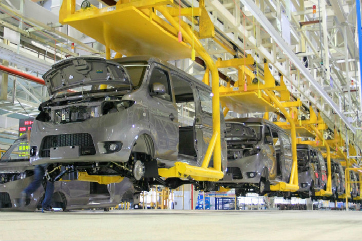 Vehicle bodies move through the Changan Automobile manufacturing plant in Chongqing, in southwestern China, on June 12, 2011. Changan and European microchip firm NXP said they have increased their collaboration into a strategic partnership to tap the smart car market. Photo: Visual China