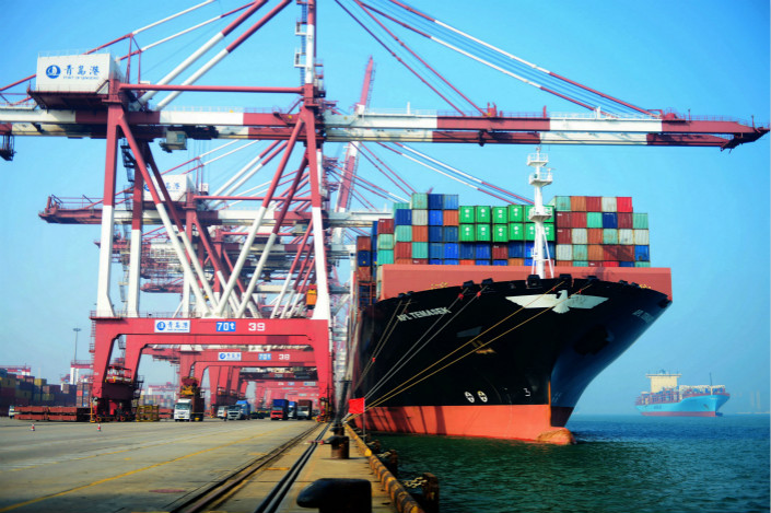 China Merchants Port Holdings Co. Ltd. has agreed to spend $919 million for a 90% stake in the facilities operator of Brazil's second-largest container terminal. Above, the Qingdao port's foreign-trade container terminal is seen on July 13. Photo: Visual China