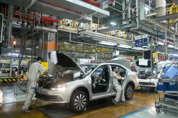 Workers work on a Volkswagen production line in the southwestern city of Chengdu on May 5. Photo: Visual China