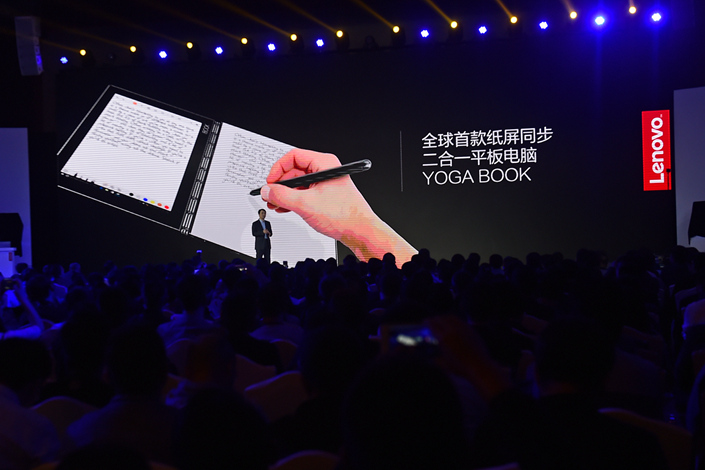 The U.S. Federal Trade Commission had accused Lenovo of harming consumers after it was discovered that some of the company's laptops had been preloaded with software that could access users' personal information. Above, a Lenovo executive introduces a product in the northern city of Tianjin in March. Photo: IC
