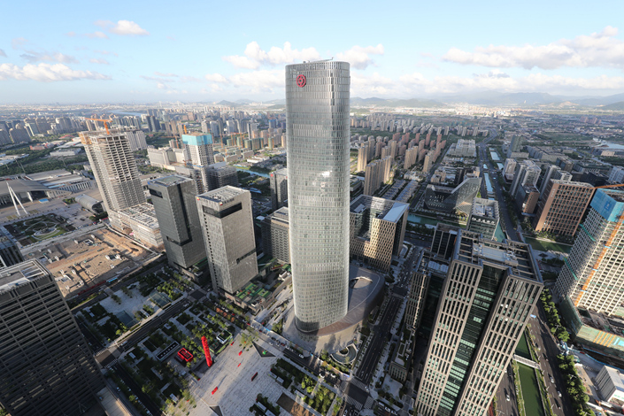 Smaller banks are hit by the authorities' recent tightening of mortgages and local-government financing, while major banks are still going strong. Above, a Bank of China building in Ningbo, Zhejiang province on Aug. 23. Photo: Visual China