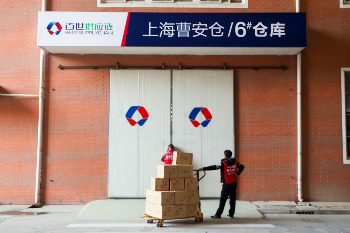 Best Inc. plans to issue 62.1 million American Depositary Shares at a price of $13 to $15 per share in a New York initial public offering. Above, a Best logistics warehouse is seen in Shanghai in November 2014. Photo: Visual China