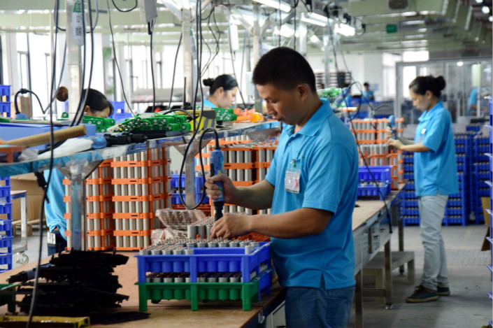 The price spike of cobalt over the past 12 months has yet to hit most companies in the new-energy battery supply chain, but that could change in the second half. Above, workers at OptimumNano Energy Co. Ltd. in Chenzhou, Hunan province, assemble batteries for new-energy vehicles on June 28. Photo: Visual China
