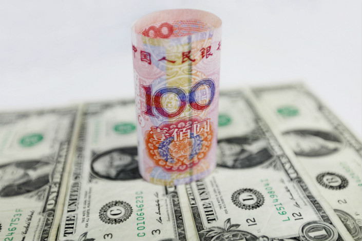 The People's Bank of China has taken measures that analysts say signal the government's intention to slow the pace of the yuan's appreciation against the dollar. Photo: Visual China