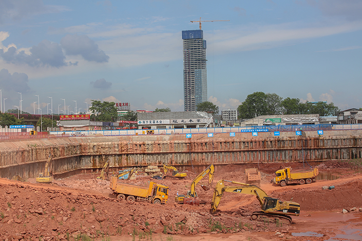The winning development bidder for a parcel of Guangzhou land slated for housing must retain ownership of the tract for the full 70 years of the land-use rights, and will be allowed to rent the apartments only to employees of industrial enterprises. Above, excavators work at a construction site in Huangpu district of Guangzhou, Guangdong province, in July 2016. Photo: Visual China