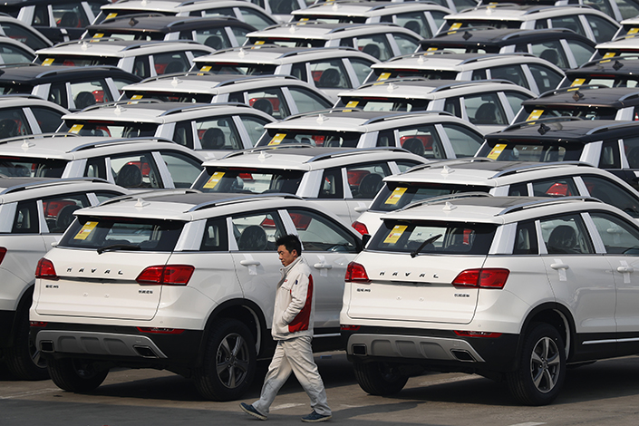 Great Wall Motors Co. Ltd. Chairman Wei Jianjun did not name the two other Chinese automakers he said will cooperate with Great Wall Motors to build an automotive plant in the United States. Above, Haval SUVs are parked outside the Great Wall Motors assembly plant in Baoding, Hebei province, on Feb. 19. Photo: IC