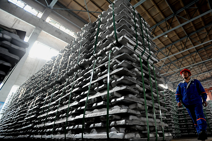 Chinese insurers are allocating more of their assets to riskier investments, as evidenced by China Pacific Insurance (Group) Co.'s deal with Aluminum Corp. of China Ltd. (Chalco) to create a $1.53 billion fund. Above, aluminum ingots are stacked at a plant of the parent company of Chalco, in Baise, the Guangxi Zhuang autonomous region, in June 2012. Photo: IC