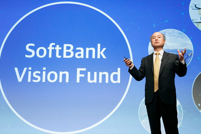 Japanese telecom and internet conglomerate SoftBank Group Corp. has surfaced as a potential cornerstone investor in Zhong An Online Property and Casualty Insurance Co. Ltd., which is looking at an initial public offering in Hong Kong. Above, SoftBank Chairman Masayoshi Son speaks at a May 10 news conference in Tokyo. Photo: Visual China
