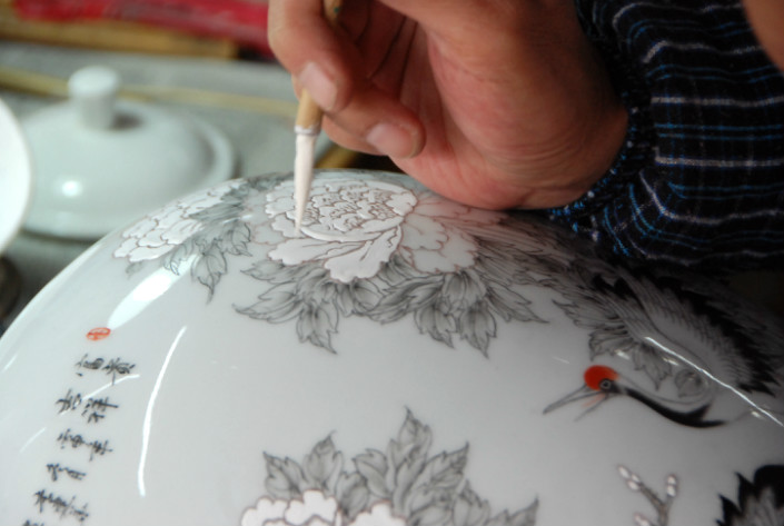Immense detail goes into the hand-painted porcelain. Photo: WildChina.com