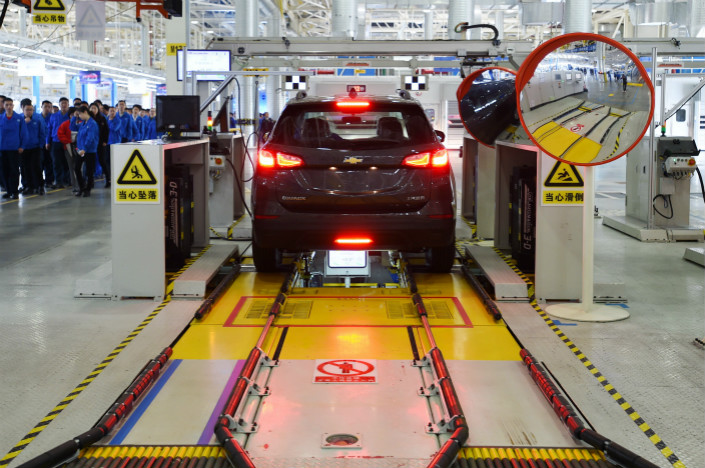 GM and its local joint venture partners sold 3.87 million vehicles in China last year, including those made at the company's Wuhan factory (above), but only a fraction of that total was electric. Photo: Visual China