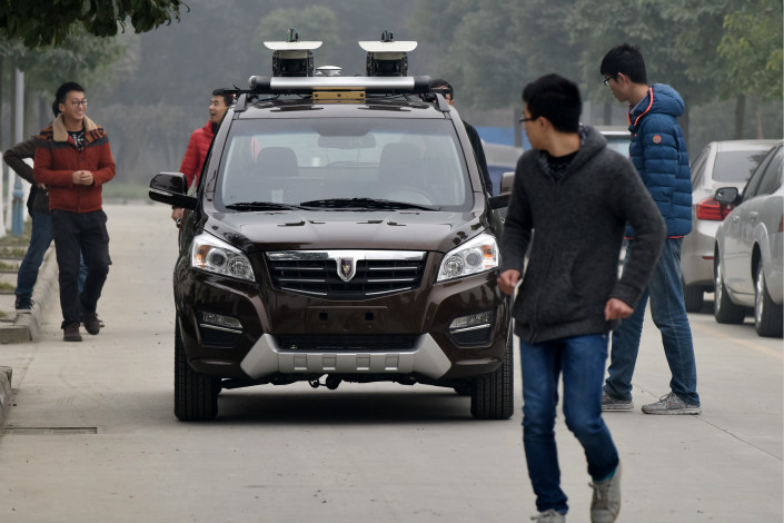 Under draft regulations, driverless cars will have to clock up to 5,000 kilometers of test driving in closed environments before being let loose on China's roads. Photo: Visual China