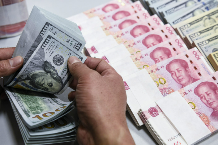 Banks in China sold $3.8 billion more foreign exchange than they bought last month, down from $15.5 billion in July and $9.5 billion a year earlier. Smaller net sales of foreign exchange by banks indicate a recovery in demand for yuan among Chinese individuals and companies. Photo: Visual China