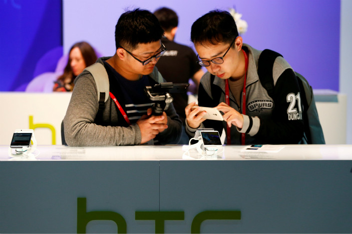 Google Inc. said its $1.1 billion investment in HTC Corp. is part of a longer-term plan for development of the Pixel brand. Above, attendees of the Mobile World Congress in Barcelona, Spain, examine the new HTC U Ultra on March 1. Photo: Visual China