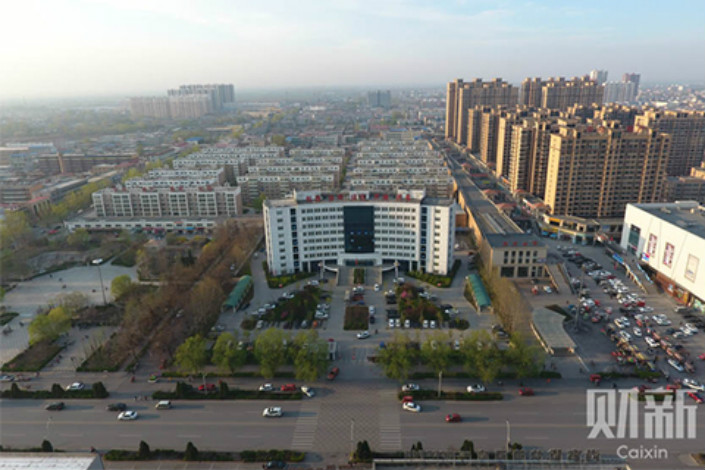 The Xiongan New Area's local authority plans to boost the construction of affordable rental properties for newcomers and establish a point-based system to determine which migrants will be qualified to purchase these homes. Above, Rongcheng county is one of three counties in Hebei province that comprise Xiongan. Photo: Chen Weixi/Caixin