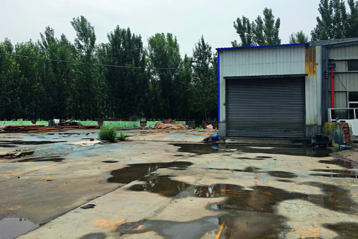 Authorities cut off water and power to this plant in Jiyang county, Shandong province, that supplies components to hydraulic lift table manufacturers there. Government inspectors had listed the plant as a polluter — a designation some businesses say that authorities are handing down for reasons not linked to pollution. Shen Fan/Caixin