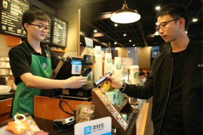 Though late to the mobile payment party, 29% of transactions at Starbuck's Chinese stores were conducted through mobile payment platforms in the first quarter of 2017. Photo: Alipay