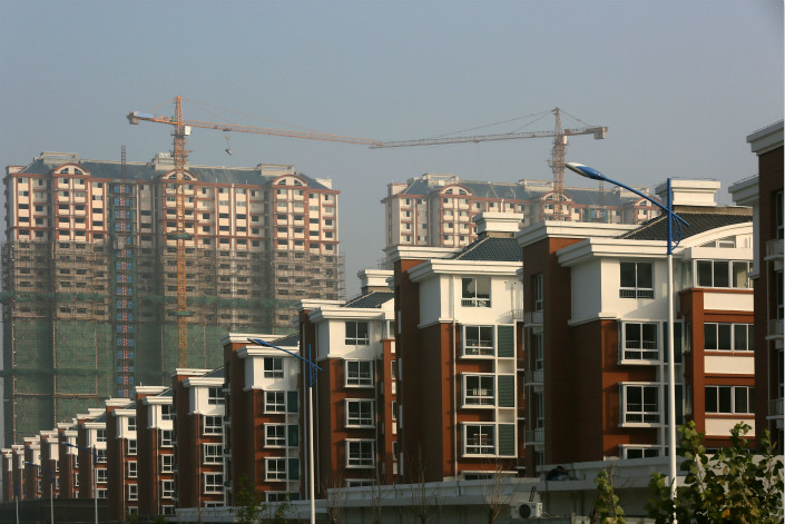 A manager of a midsize bank has told Caixin that if borrowers are found to be using consumer loans to buy homes, the bank will demand they immediately pay back the principal and interest on those loans. Above, residential housing is seen in Huaian, Jiangsu province, on Tuesday. Photo: Visual China