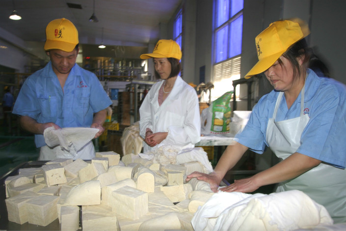 As of the end of June, the outstanding value of loans to small companies in China, similar to this (pictured) tofu factory in the eastern province of Zhejiang, stood at 22.6 trillion yuan, up 59.7% from the end of June 2014. Photo: Visual China