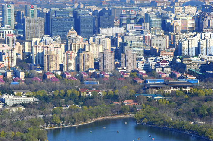 Beijing's lottery will be for 427 so-called shared-ownership homes, in which ownership will be split at a certain ratio between eligible homebuyers and the government. The goal of the lottery is to provide local residents with more affordable housing. Photo: Visual China