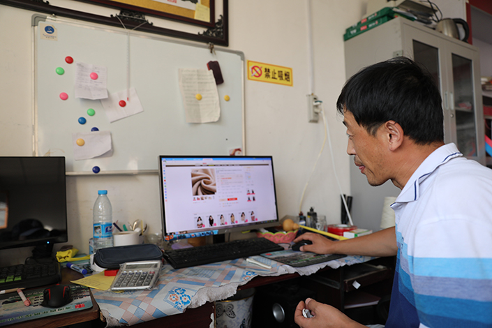 A local owner of a cashmere wool plant checks on his online shop from a laptop in China's northern Hebei province. Photo: Ant Financial Services Group