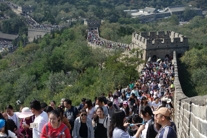 The China National Tourism Administration said that reservations on the accommodations website Airbnb more than doubled over the National Week holiday from last year. Above, tourists visit the popular Badaling section of the Great Wall in Beijing on Wednesday. Photo: Visual China
